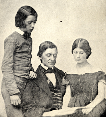 Photograph of Ralph Waldo Emerson reading with adolescents Edward and Edith, from Emerson family photograph album.