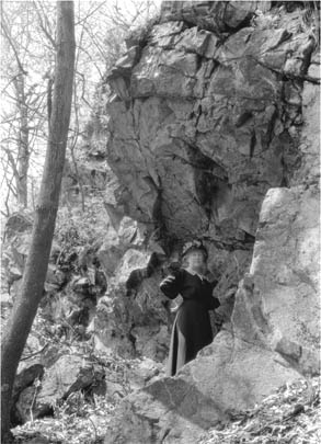 L.W.G. [Mrs. Gleason]  in Thoreau's cave at Lee's Cliff